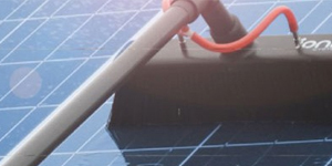 Reach and wash system to clean a solar panel